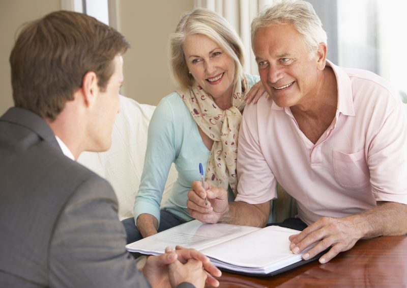 42400979 - senior couple meeting with financial advisor at home