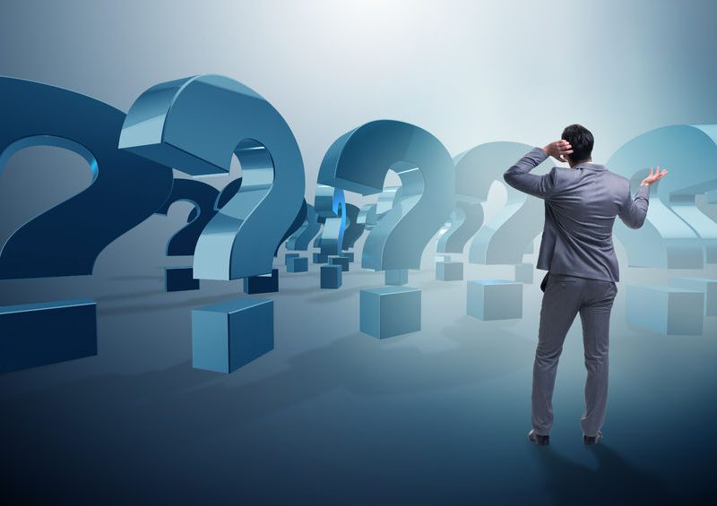 69481672 - businessman in uncertainty concept with question marks