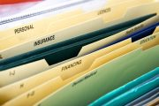 Close up of domestic personal files in expanding pocket folders